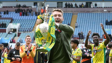 Tom Trybull of Norwich with the trophy at the end of the Sky Bet Championship match at Villa Park, B