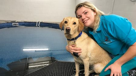 Rachel Lambert with her labrador, Blue, at Doggy Paddle swimming pool in Norwich. Picture: Lauren De