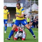 Asa Hall, Captain of Torquay United battles for the ball with Josh Hancock of Altrincham during the