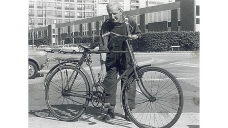 """Mr """"Dodger"""" Kerrison with a World War One bicycle that has beeen brought to his shop in Cambridge St"""
