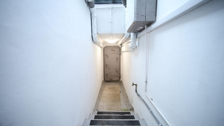 The bunker can be accessed through a heavy, secure door, after descending underground through a door in the garden