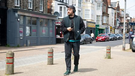 Artist Oliver Payne gathering recordings on Great Yarmouth High Street for High Street Sound Walks.
