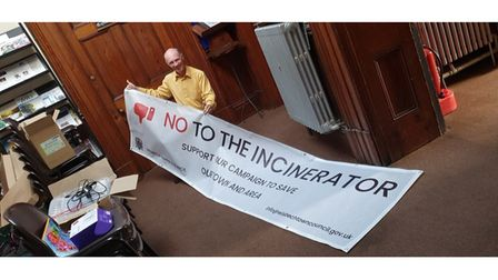 Town clerk Terry Jordan pictured last year with an early banner