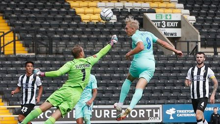 Torquay United player Danny Wright heads past Notts County keeper Sam Slocombe to put Torquay in fro