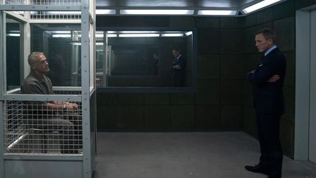 James Bond (Daniel Craig) visits Blofeld (Christoph Waltz) in his prison cell in No Time To Die.