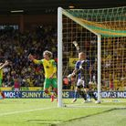 Kenny McLean of Norwich heads the ball into the net for what would have been the equaliser sparking