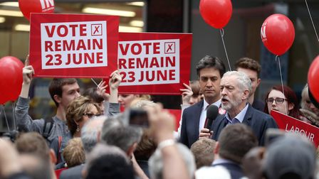 Jeremy Corbyn and former leader Ed Miliband (L) address supporters and members of the public in Donc