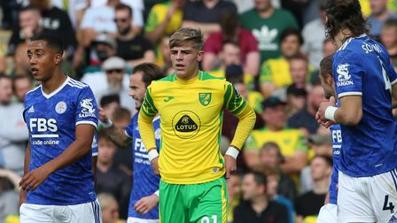 Brandon Williams of Norwich looks dejected as Jamie Vardy of Leicester City celebrates scoring his s