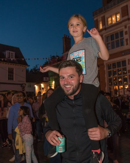 A young person on a man's shoulders, Dance in the Square, Saffron Walden, Essex, August 2021
