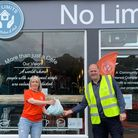 Rotarian Martin Smith collects bottle tops from Amanda at the No Limits café in Newton Abbot.