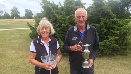 Anne Peers and John Black, the winners of the Lucy and Natalie Godfrey trophies at Heydon Grange Golf Club.