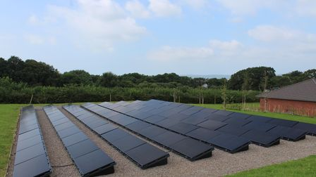 A bank of solar panels helps power the new facility