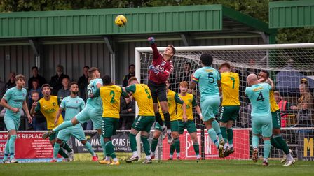 Charlie Horlock of Hitchin Town punches clear as Royston Town press at Top Field.