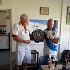 Paignton Bowling Club president B Smith receiving the shield from Paignton and Torbay Bowling Club president D Crown.