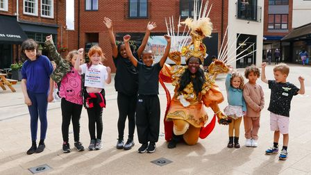 Micaelia Clarke from Black Voice Letchworth gives children a free lesson in carnival dance during th