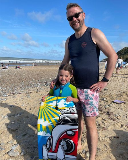 James Ellis, pictured on Cromer beach wearing his wedding ring with daughter, Isabelle; five.