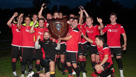 East Allington United celebrate their Charity Shield victory.