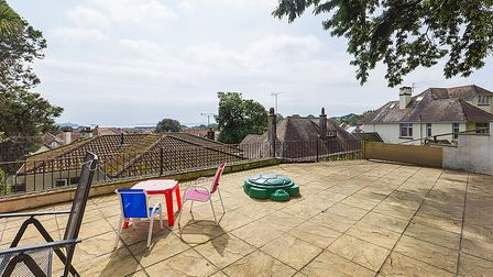 large patio area on level two, perfect for entertaining guests with beautiful sea views on offer