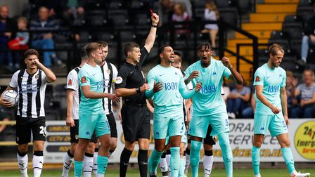 Ref Martin Woods shows Torquay United player Ali Omar a red card during the Vanarama National League