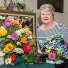 Linda Wright with her display at Wedmore Flower Festival.
