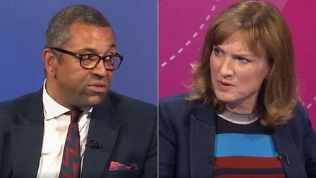 Junior Tory minister James Cleverly (L) and BBC Question Time presenter Fiona Bruce during a debate