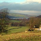 View down valley, with farmhouse. Nidderdale, North Yorkshire.