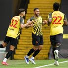 Watford's Andre Gray (centre) celebrates scoring their side's first goal of the game during the Sky