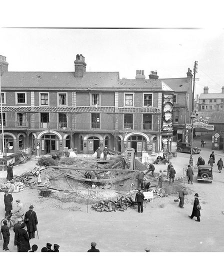 Denmark Road in Lowestoft, the bomb crater between Lowestoft railway station and the Imperial Hotel.
