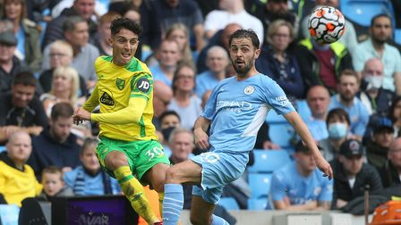 Dimitris Giannoulis of Norwich and Ilkay Gundogan of Manchester City in action during the Premier Le