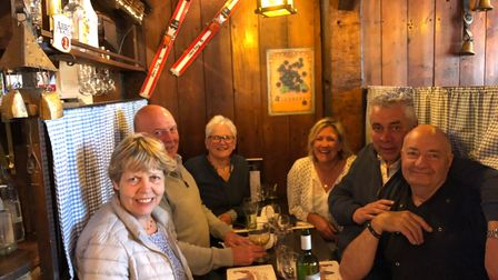 Terry and Margaret Butler, front, at Crofters in Sheringham with with a group of longstanding customers.