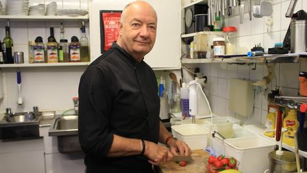 Terry Butler, who is back in the kitchen of his High Street restaurant, a month after being forced t