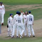 Shane Snater of Essex celebrates with his team mates after taking the wicket of Dan Douthwaite durin