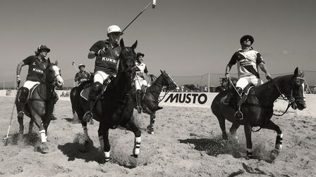 Five riders take to the sand holding polo sticks ready for the championships