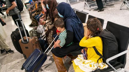 Embargoed to 1800 Thursday August 26 Refugees from Afghanistan wait to be processed after arriving o