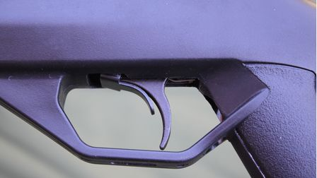 Close up of the trigger on the Crosman Fire air rifle