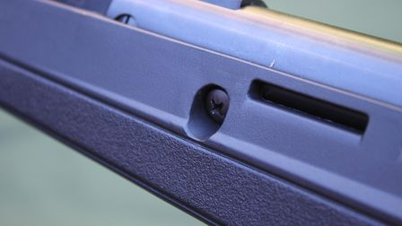 Close up of angled stock screws on the Crosman Fire air rifle