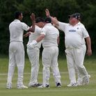 M Irfan of Hornchurch celebrates with his team mates after taking the wicket of L Hawes during Bille