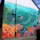 A mural of bottle nose dolphins in Aberystwyth.