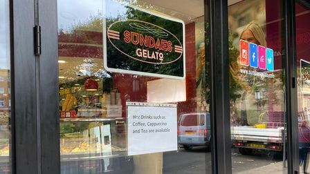A sign for Sundaes Gelato in Norwich advertising hot drinks