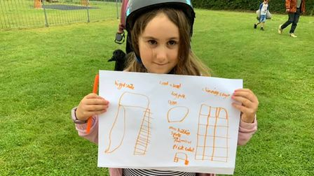 Four-year-old Scarlett with her ideas for the Cooper Road play park in Sheringham.