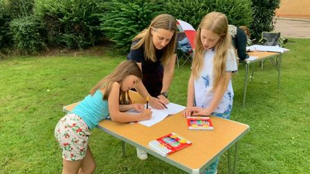 Youngsters drawing their ideas for the Cooper Road play park in Sheringham.