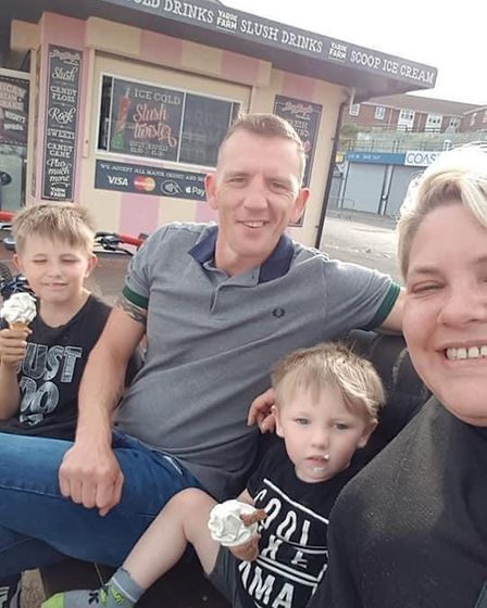 Gina Stevenson, from Gorleston, with her sons and partner.