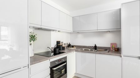 A stylish apartment kitchen with fully fitted appliances at Regency Heights in Brent