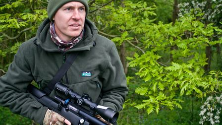 Phil Siddell hunting with an air rifle in woodland