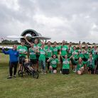 Riverside Runners pose by an airplane after the inaugural running of the Little Gransden 10k.