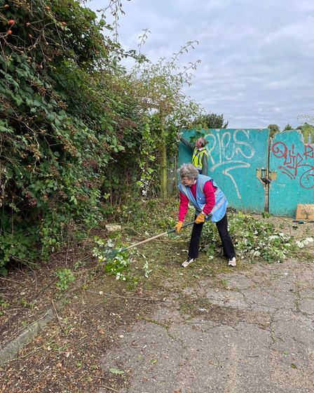 A volunteer clearing the Sale Yard area of Wymondham.