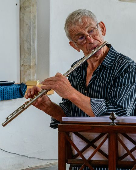 Cley-based flautistWyatt Earp played during the book sale Cley church.