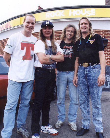MEMBERS OF IRON MAIDEN PICTURED WITH OVAL ROCK HOUSE LANDLORD CHRIS HILES (SLEEVELESS T-SHIRT)IN 199