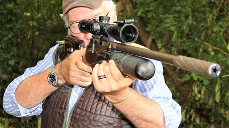 Terry Doe shooting the Daystate Red Wolf Heritage LE air rifle, free hand standing, in a garden setting