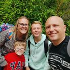 Emma and Chris Taylor with their children Eli, (seven), front, who has Down's syndrome, and Logan, 12.